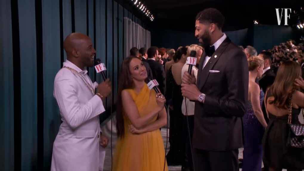 Karamo Brown and Catt Sadler speaking with a basketball player