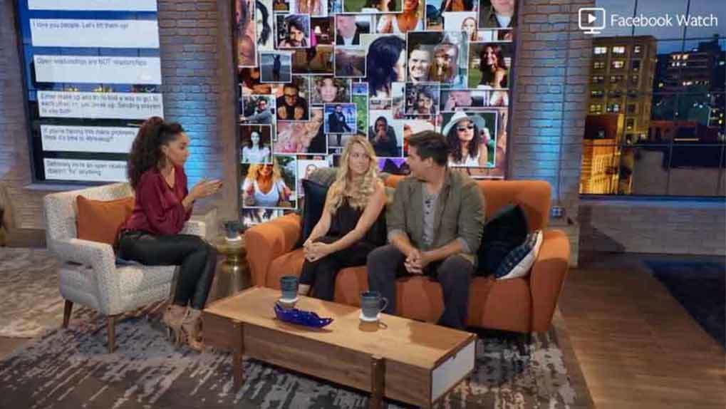 Shannon and couple sitting on the couch with fan feed wall in the back screen