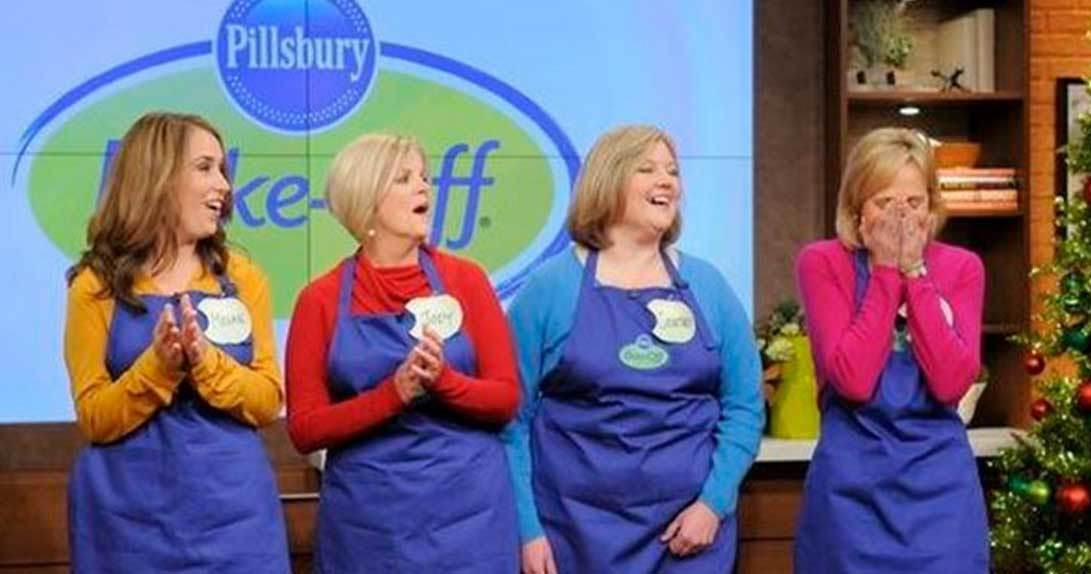 Four women standing onstage in aprons