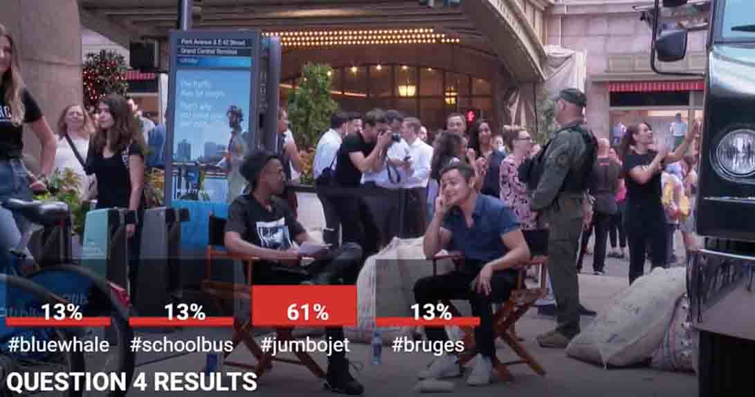 Interviewer and actor sitting outside with bar graph showing audience answers and percentages