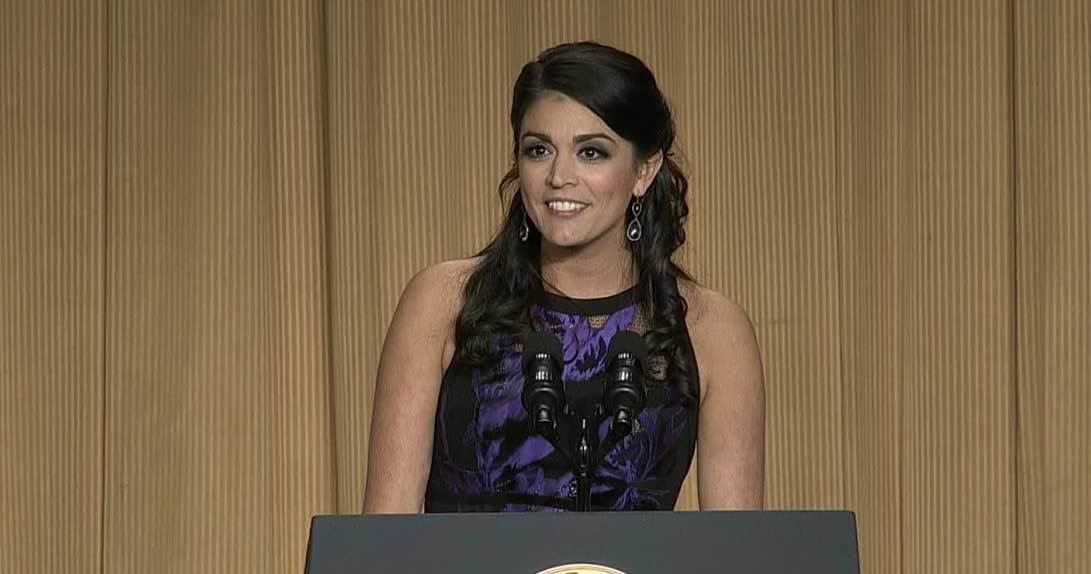 Cecily Strong standing at podium