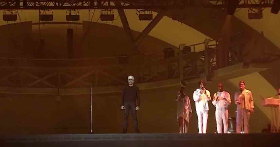 Chance the Rapper onstage with three people