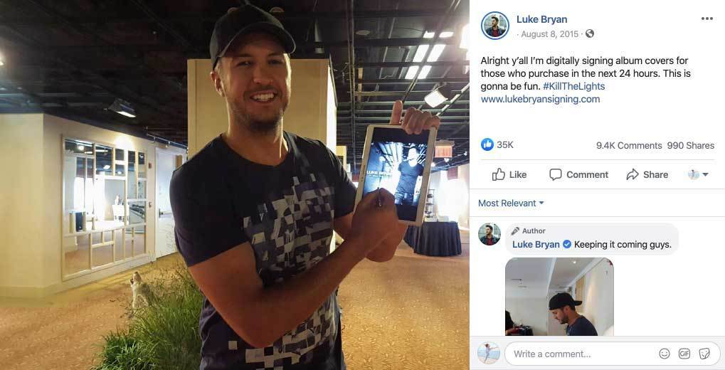 Luke Bryan holding tablet and signing it with stylus - Luke Bryan FB post and comments
