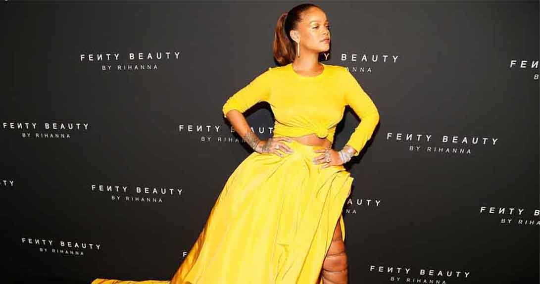 Rihanna in yellow dress on red carpet
