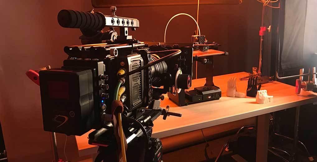 Movie camera pointed at 3D printer