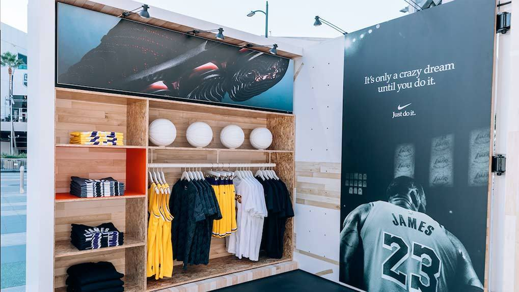 Pop up store with basketball apperal such as jerseys shorts and image of lebron james