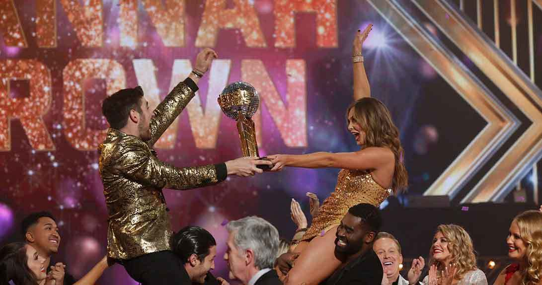DWTS couple holding trophy