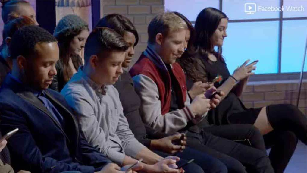 audience on their phones voting in the Facebook Watch comments