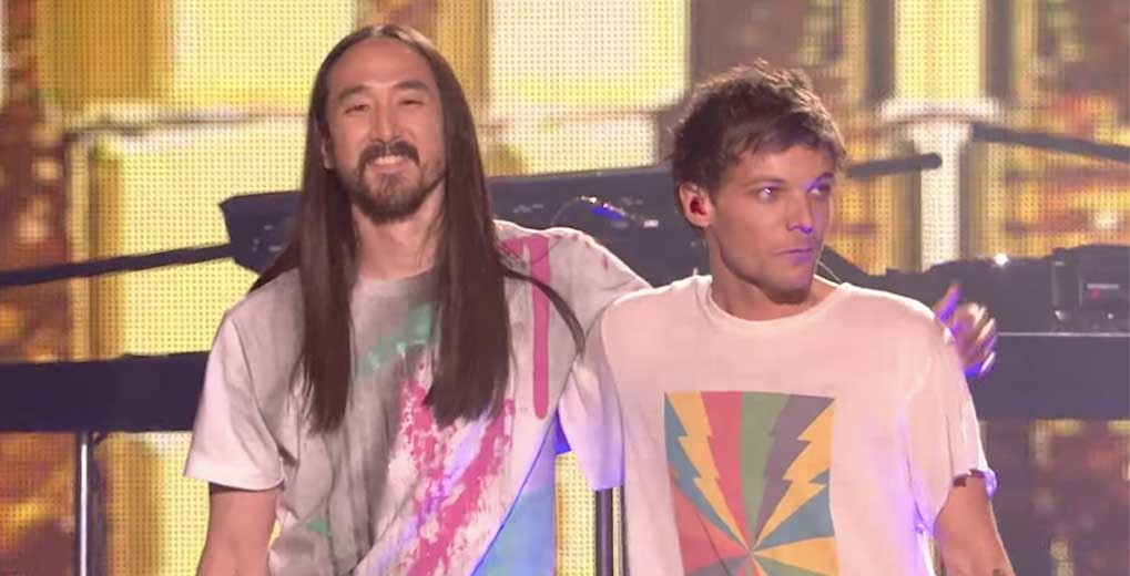 Steve Aoki and Louis Tomlinson on stage
