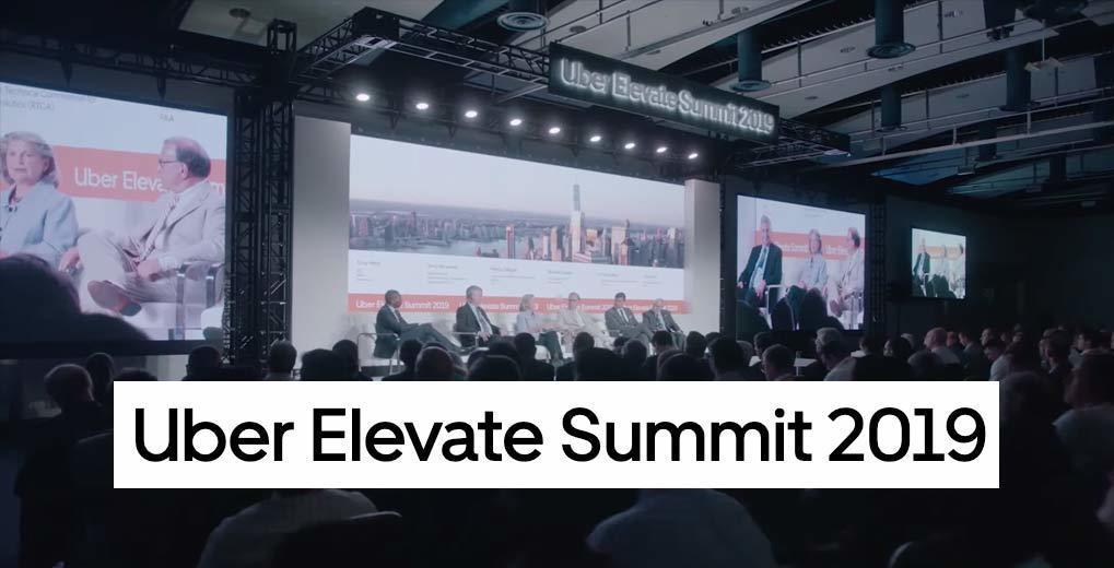 Uber Summit panel sitting on stage