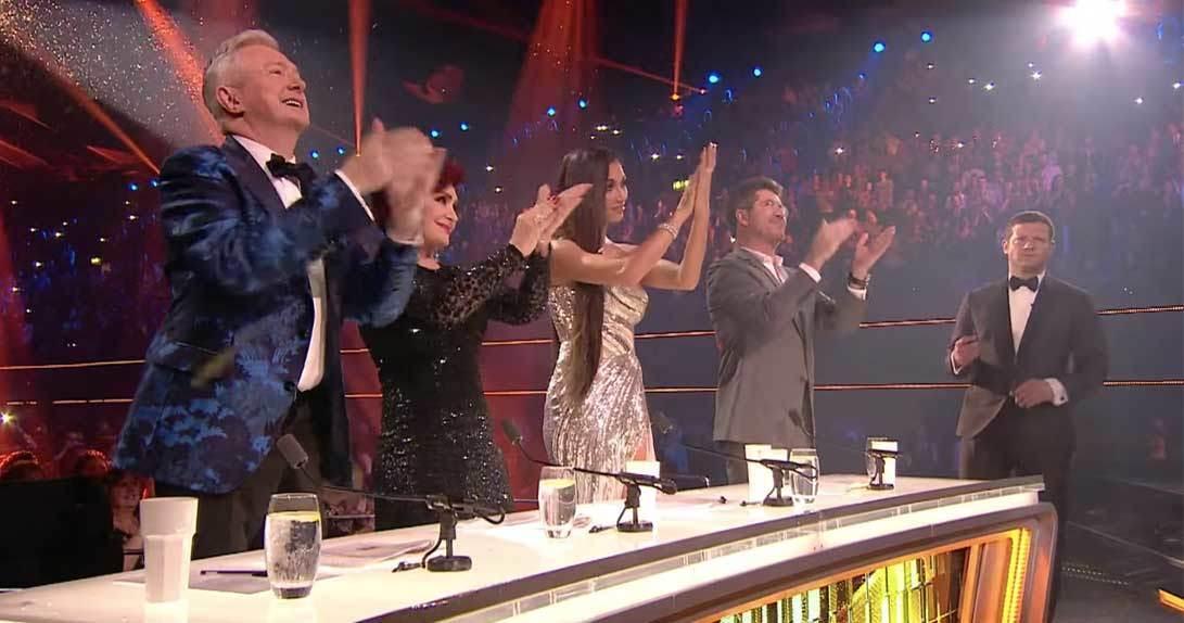 X Factor judges giving standing ovation