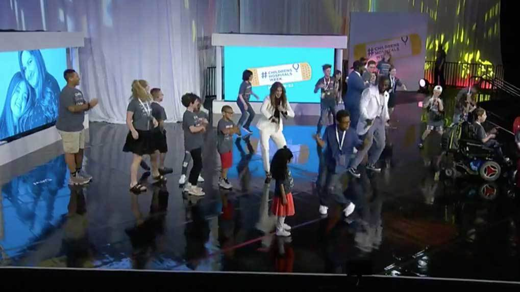 pediatric patients dancing on stage with interviewers