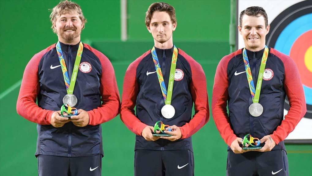 US Male Olympic Team receiving silver medals
