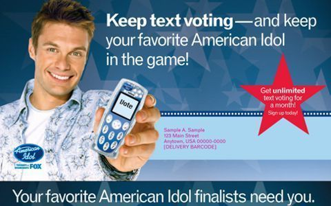 Ryan Seacrest holding out a phone