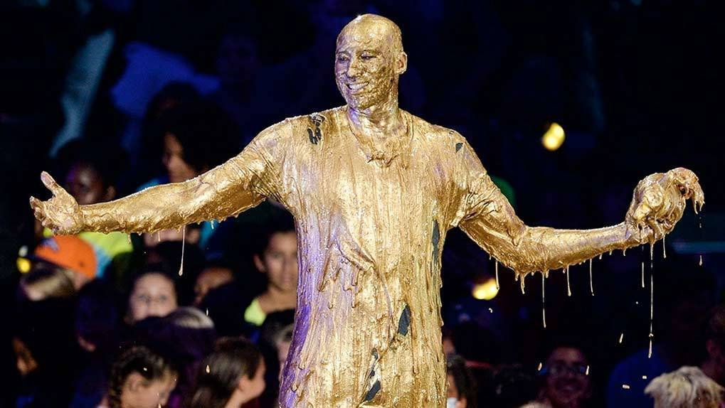 Man dripping in gold paint
