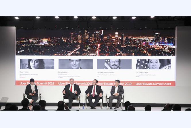 Panel of speakers sitting on stage