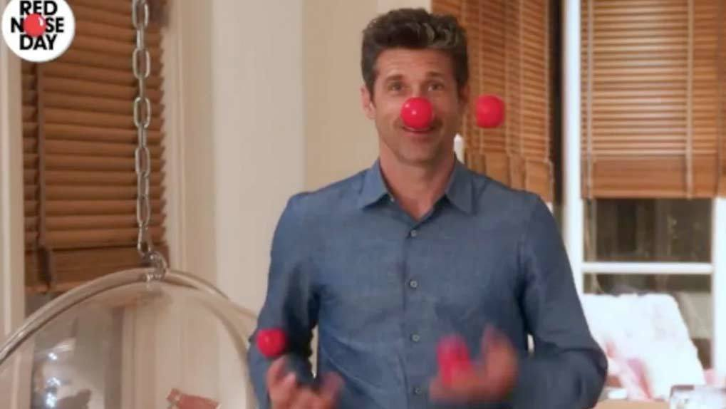 Patrick Dempsey jungle red noses while wearing a red nose