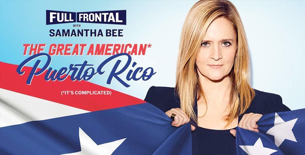 Samantha Bee holding US flag
