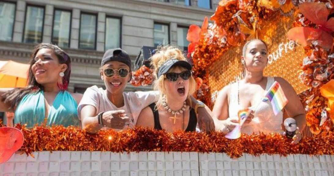 Four women standing on orange float