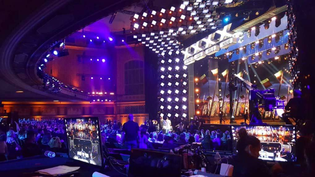 Audience view of the AGT Stage with person sitting at computer