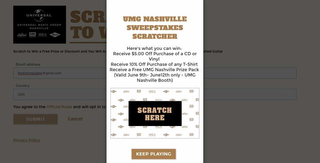 "UMG Scratcher Sweepstakes pop up telling the user to ""scratch here"""