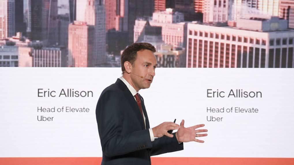Eric Allison speaking on stage