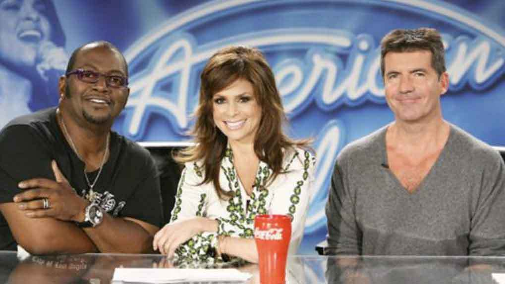 American Idol judges smiling including randy jackson