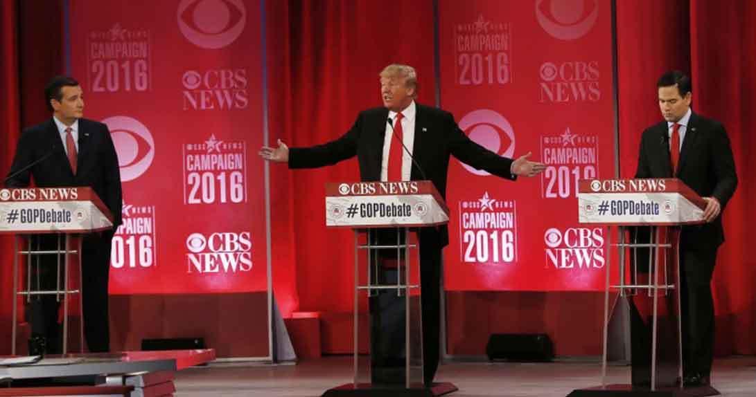 Republican candidates debating from behind podium