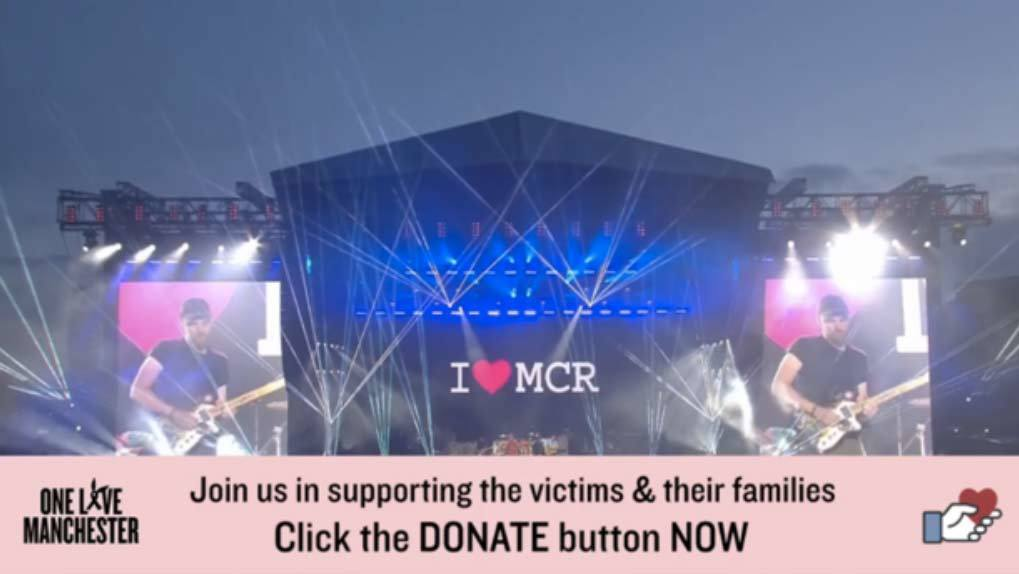 View of the stadium stage with I heart MCR on screen and donate CTA on screen