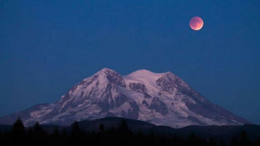 Blood moon over mountains