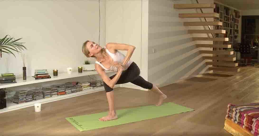 Actress doing yoga twist