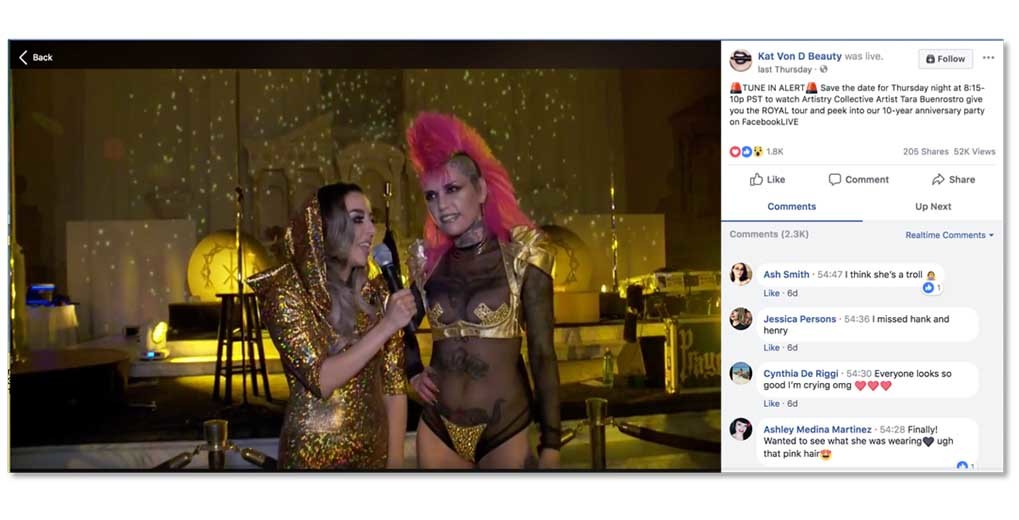 FB live stream of two women talking in eccentric outfits with FB comments