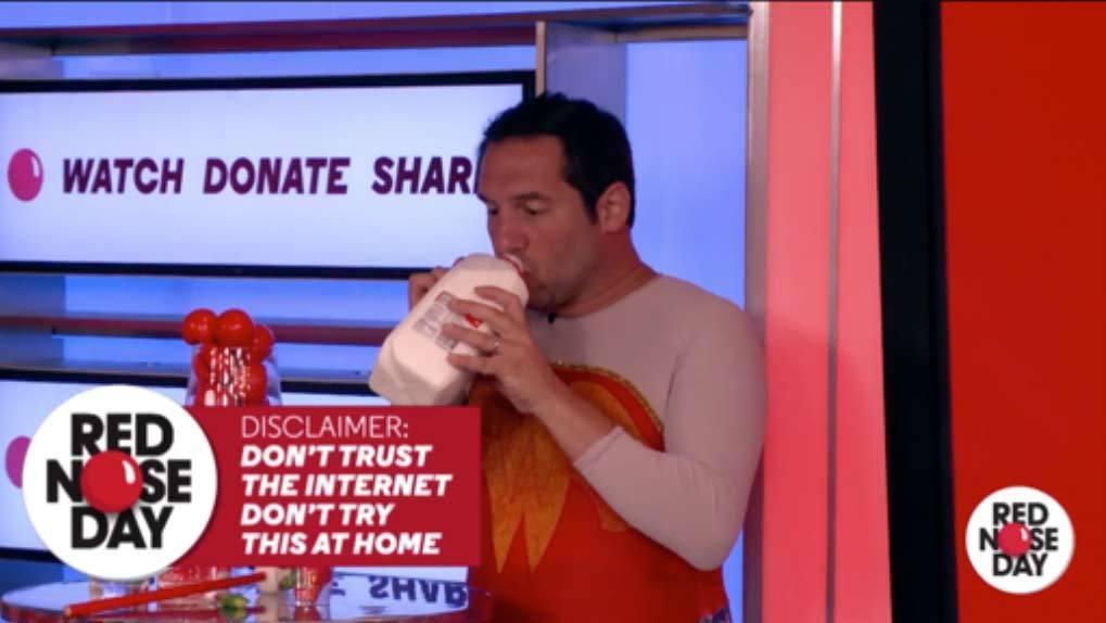 Man dressed like Wonder Woman drinking gallon of milk on screen